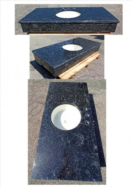 NERO MARQUINA top bagno <br />finitura lucida, spessore 3 cm<br />Formato: 130x65x18 cm<br />con lavello in Bianco Statuario diametro 39 cm, profondità 17 cm<br />Prezzo: € 680,00