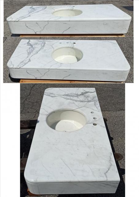STATUARIO top bagno<br />finitura lucida, spessore 3 cm<br />Formato: 140x65x18 cm<br />con lavello in Bianco Statuario diametro 39 cm, profondità 16 cm<br />Prezzo: € 830,00
